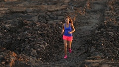 Running runner woman trail running cross country running on volcano Stock Footage