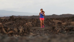 Running sport and fitness runner woman cross-country trail run training outside Stock Footage