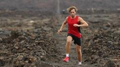 Athlete running - male runner exercising on trail running training for triathlon Stock Footage