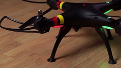 Drone Syma X8W with included flashing lights standing on a wooden floor Stock Footage