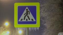 Road sign on ice. Frozen rain. Stock Footage