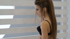 Sexy woman in black lingerie on photo session. Photo-shoot. Young European woman Stock Footage