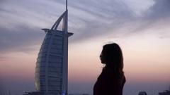 Tourism attraction Burj al Arab background pretty woman admiring landscape Dubai Stock Footage