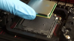 Person establishes in an ASUS motherboard processor (AMD) and corrects it. Stock Footage