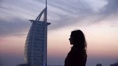Woman silhouette in Dubai emirate look Burj al Arab hotel tourist exotic trip 4K Arkistovideo