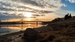 Ducks and seagulls fly on the river in the city at sunset, Tver, Russia Stock Footage