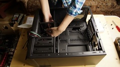 Girl sets of the components in the system unit. Stock Footage
