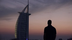 Portrait of luxurious vacation expensive holiday in exotic Dubai man sightseeing Stock Footage