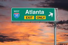 Atlanta Exit Only Freeway Sign with Sunrise Sky Stock Photos