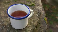 Hot tea in garden Stock Footage
