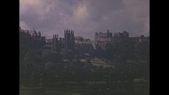 Vintage 16mm film, 1952, Scotland Edinburgh, skyline with castle, traffic Stock Footage
