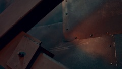Solid metal wall in the orange light from the interior of the loft Stock Footage
