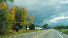 Drive along typical American way. The road between the small towns of the State Stock Footage