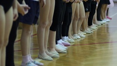 Children gym class for girls - a group engaged in dance gymnastics - legs Stock Footage