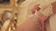 Bride correcting stockings Stock Footage