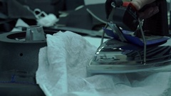 Seamstress stripped iron stitched detail Stock Footage