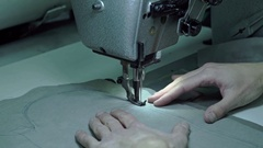 Taylor sews part of the sewing machine Stock Footage
