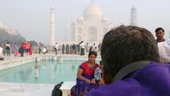 People visiting Taj Mahal in Agra, India Stock Footage