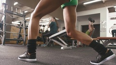 Young woman with beautiful body does exercises on her legs Stock Footage