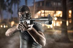 Close-up of man in headgear aiming with sniper rifle Stock Photos
