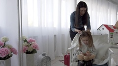 Hairdresser making hair-do little cute girl Stock Footage