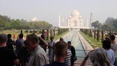 Tourists taking photos of Taj Mahal in Agra, India Stock Footage