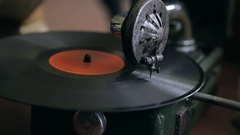 Turntable playing vinyl close up with needle on the record Stock Footage