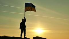 4K. Soldier silhouette waves Ukrainian Flag, sunrise time   Stock Footage