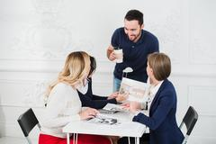 Multicultural team of designers looking at a project Stock Photos