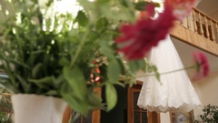 The perfect wedding dress with a full skirt on a hanger in the room of the bride Stock Footage