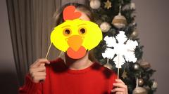 Girl holding banners with chiken's face and snowflake Stock Photos