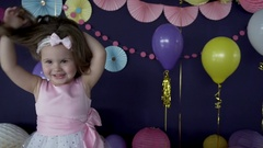 Cute little baby girl laughing and playing on her birthday party Stock Footage