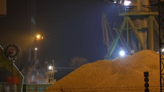 Crane at the port of loading rubble Stock Footage