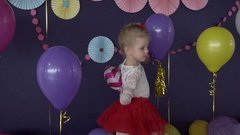 Little pretty girl dancing on her birthday party Stock Footage