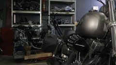 Man touches the supercharger of the chopper at the motorcycle workshop Stock Footage