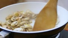 Sautéing mushrooms Stock Footage