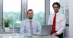 Attractive Confident Business Men Partners Looking Camera Office Interior Room Stock Footage