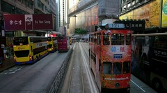 HONG KONG -  City centre tram ride with people on crosswalk in the end of clip. Stock Footage