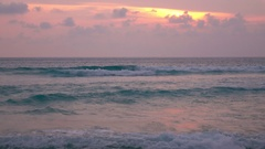 Tropical beach in amazing pastel colors with sun flecks on the water surface. 4K Stock Footage