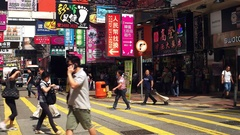 HONG KONG - People crossing shopping street with colorful signboards. 4K Stock Footage