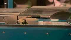 A worker sawing the board on the furniture factory Stock Footage
