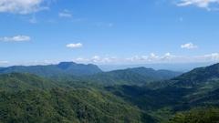 Panning shot of mountain with blue sky at Khao Kho, Phetchabun, Thailand Stock Footage
