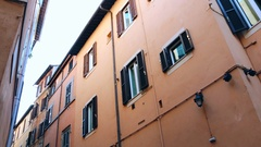 Rome, Italy - low angle view of typical roman buildings on the street. Stock Footage