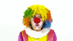 Close-up of young hilarious clown making funny faces Stock Footage