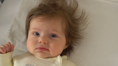 Adorable baby in the bed Stock Footage