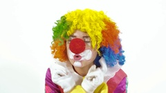 Portrait of dancing clown against white background Stock Footage