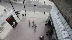 Barbican cinema London  with pedestrians and traffic on busy London street Stock Footage