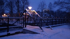 Winter frosty night view diagonally to the metal bridge over the canal. Stock Footage