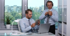 Happy Business Team Relax Listen Music on Mobile Phone Reading Newspaper Office Stock Footage