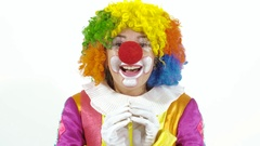 Young funny clown making faces and looking surprised Stock Footage